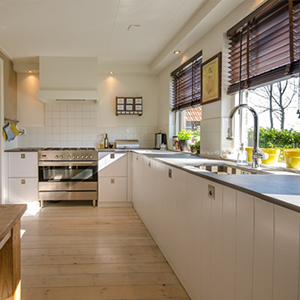Brightly light kitchen with white cabinets and pine flooring